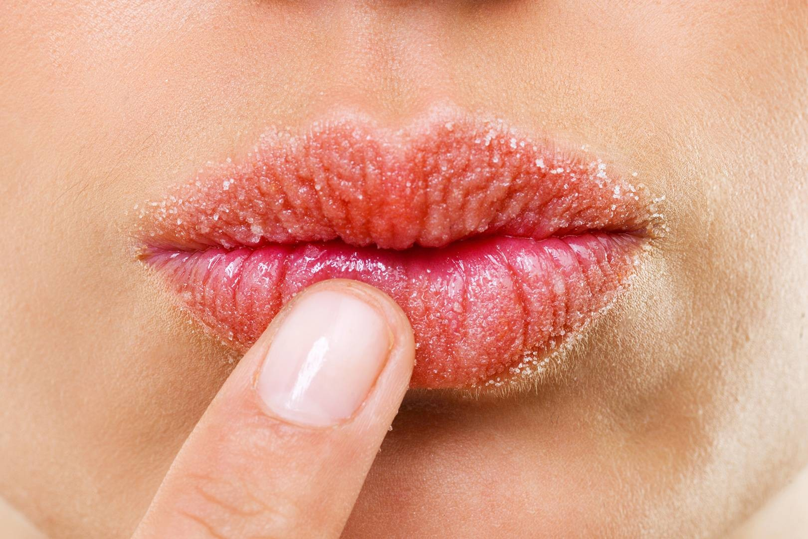 be sure to drink: pressed against badly chipped, sore looking, lips.