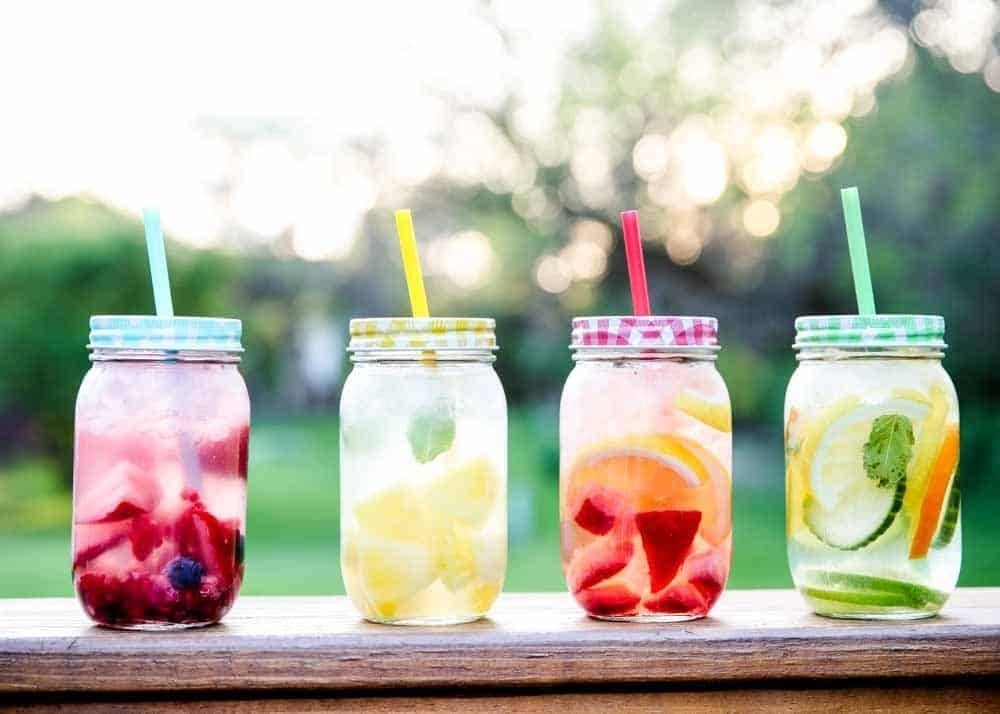 for drink: four glass jars, all full with water, and a variety of fruit in each. All containing different coloured straws.