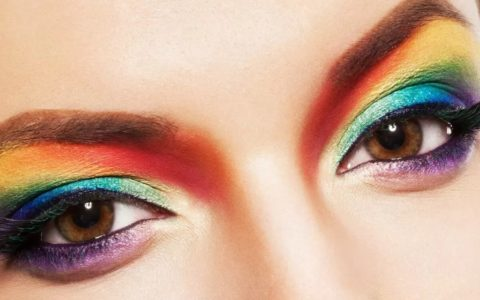close up of a woman's eyes showing rainbow eyeshadow colours.