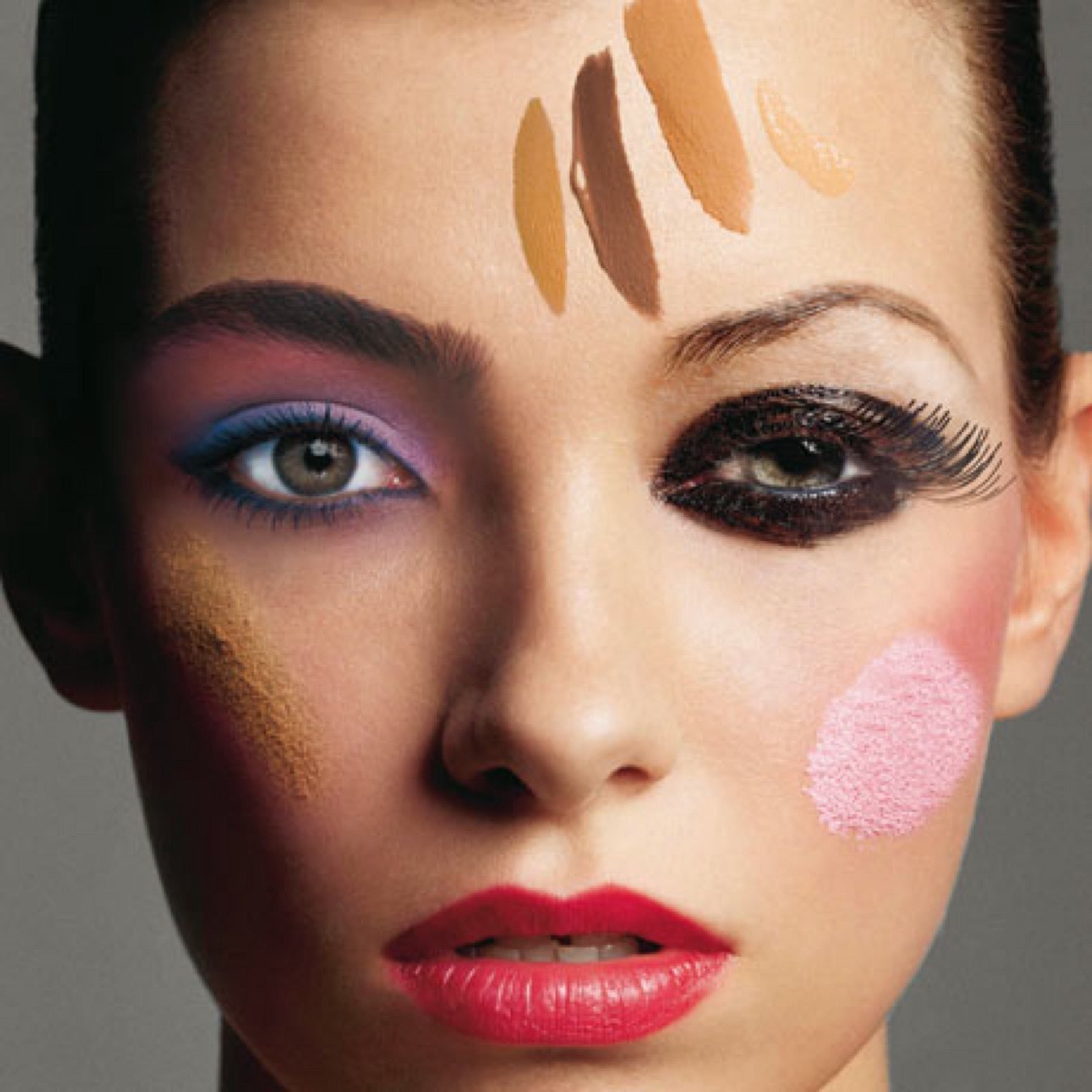 too many makeup types on one woman's face, including red lips, smoky eyeshadow, pastel eye, blusher, bronze, multiple foundation shades.