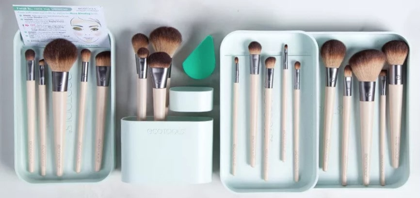 choosing Eco-friendly: four trays containing vegan makeup brushes and tools.