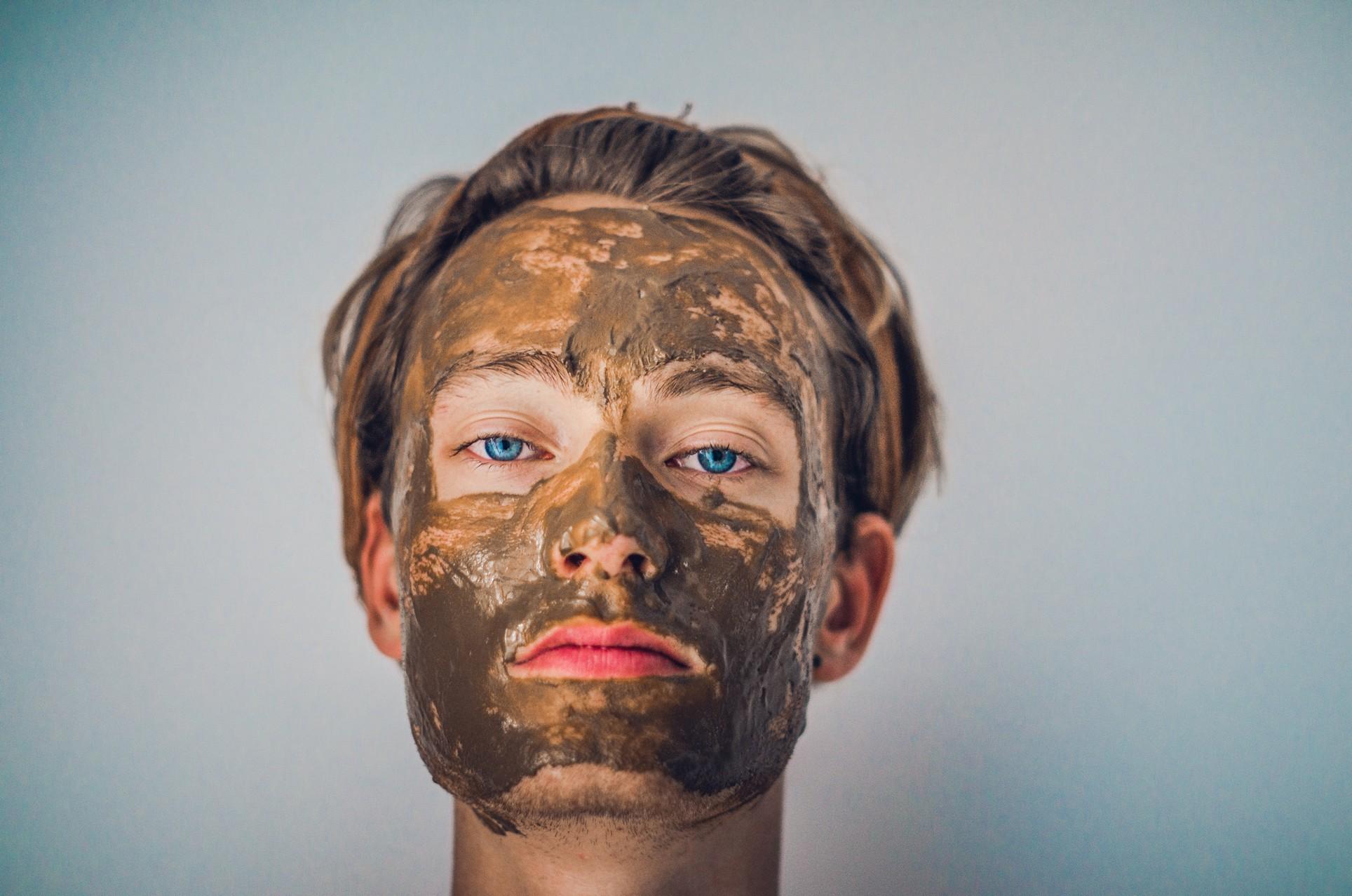 man wearing a mud face mask.
