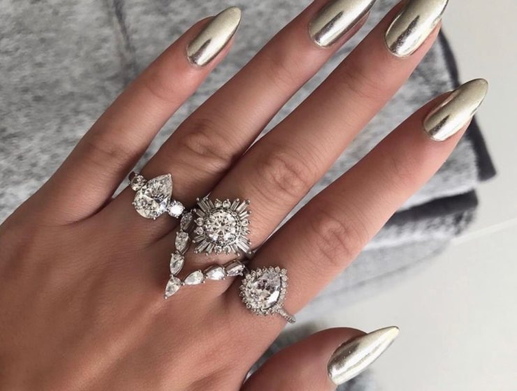 long, pointed, silver chrome nails, with matching silver rings.