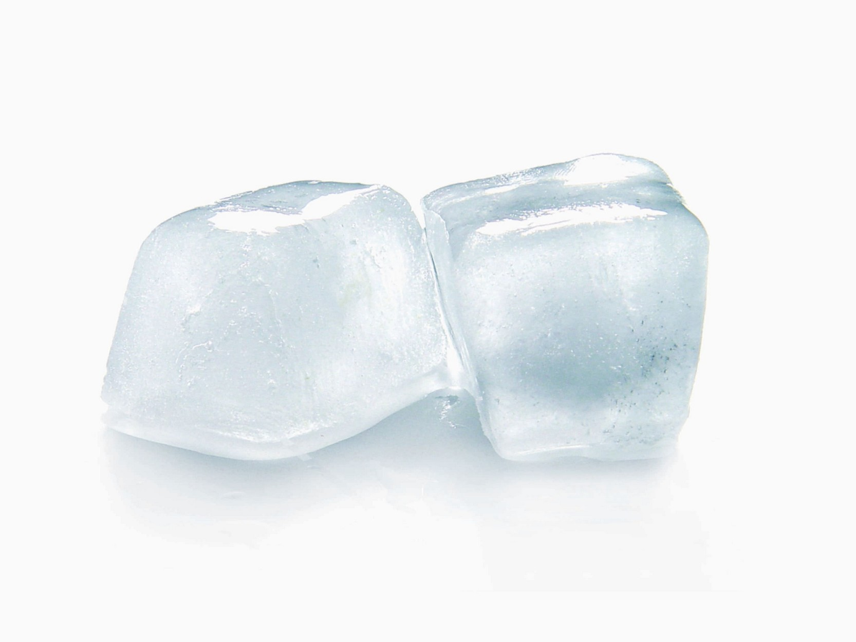 two ice cubes on a white background / ice can help pain associated with sunburn.