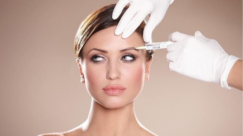 woman having facial injections.