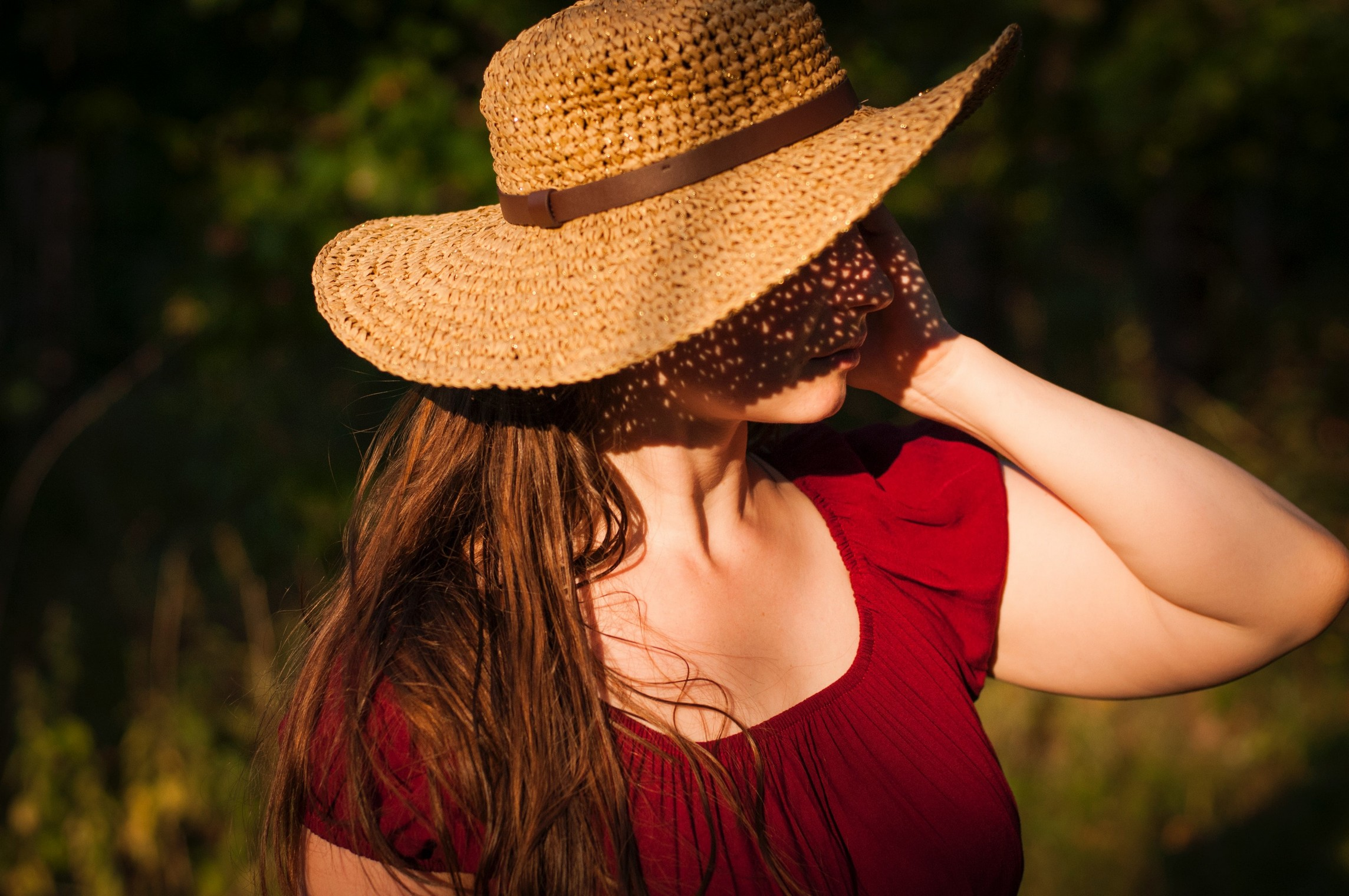 woman wearing a hat in sunshine, which is always advisable during a heatwave.