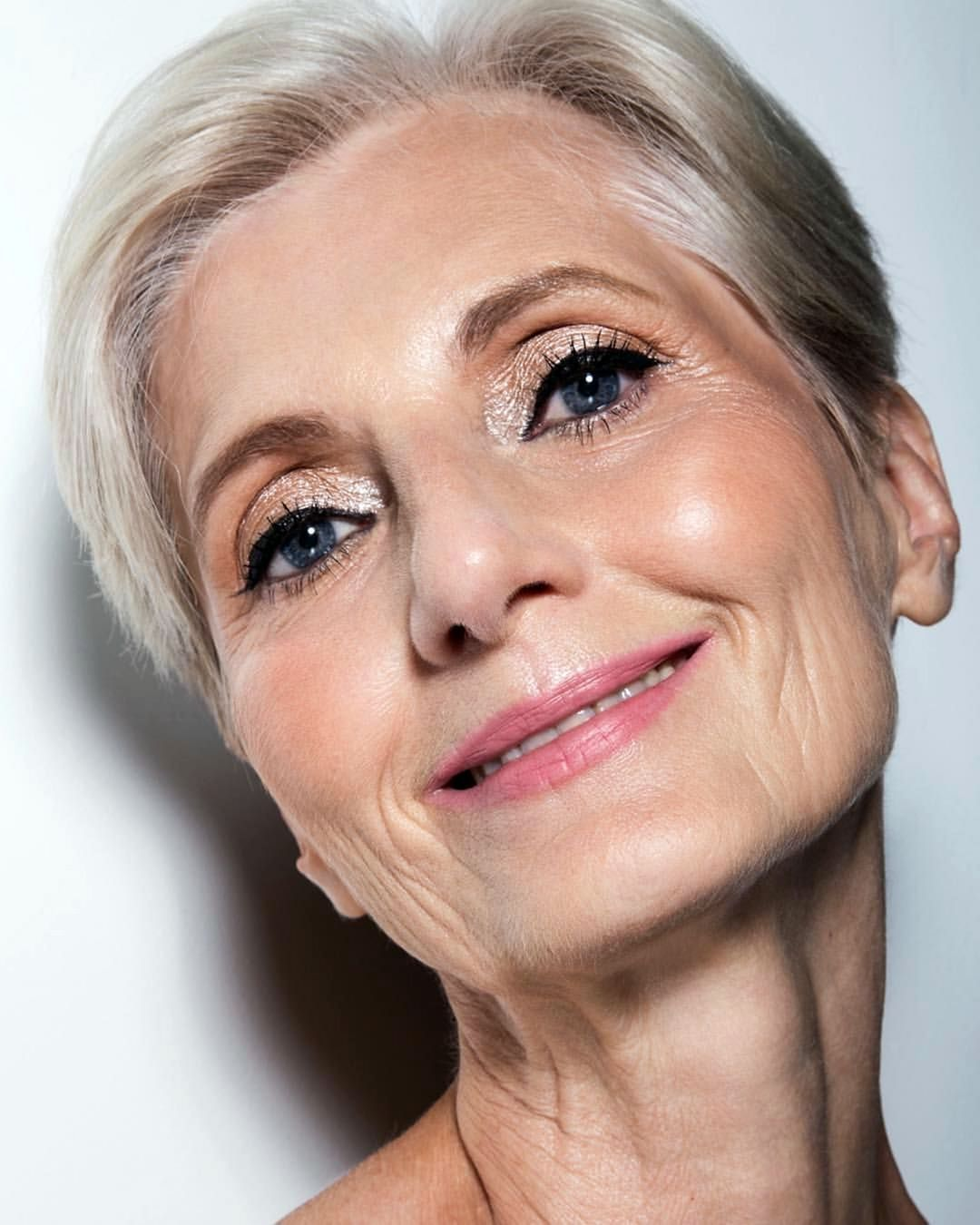 woman with mature skin and perfect makeup, after using an anti-ageing skincare routine.