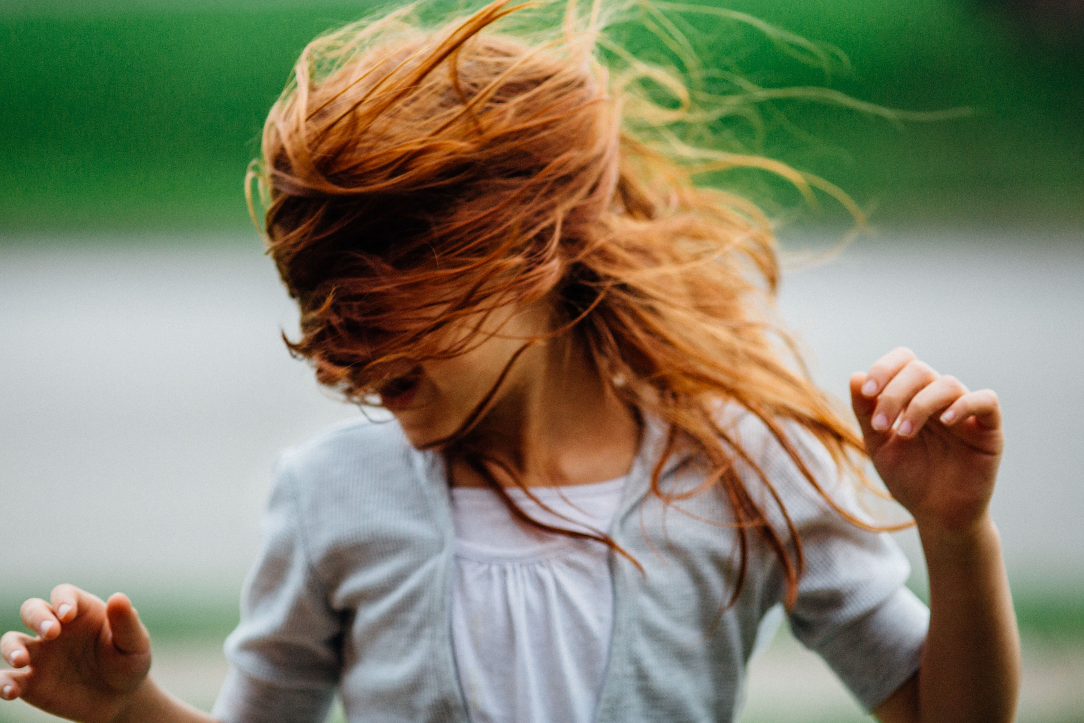 Hair Myths: womans hair blowing fiercely in the wind.