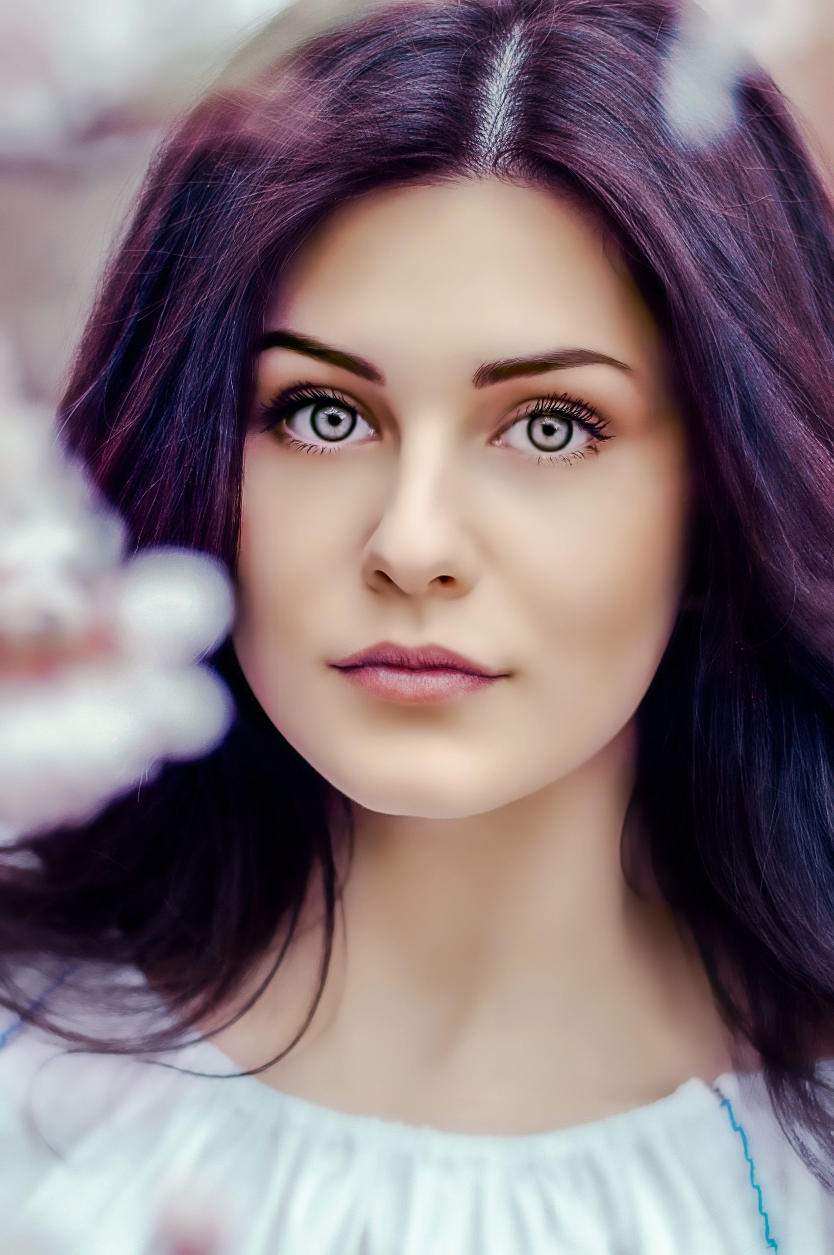 beautiful woman pictured with bright, darkened, purple hair.