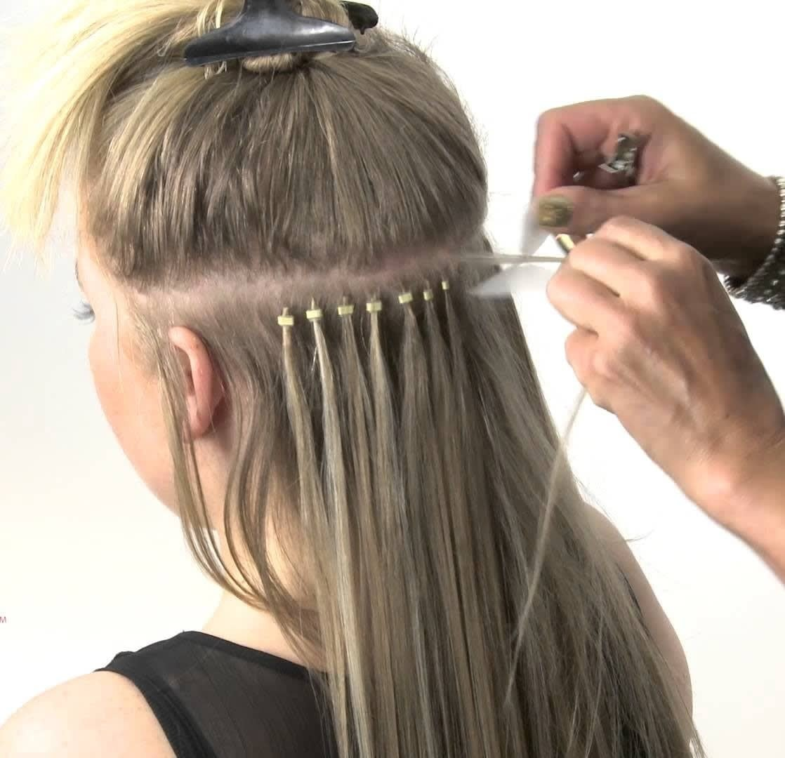 close up of a person having micro-ring hair extensions.