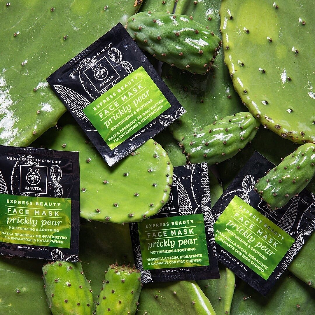 array of cactus prickly pear mask packets on cactus background.