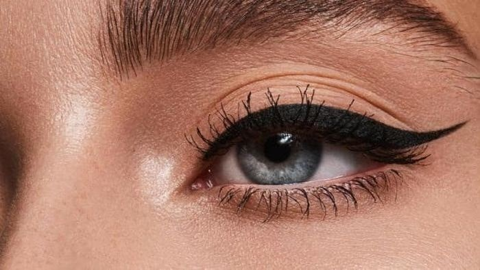 close up of a womans' eyeliner, perfectly winged.