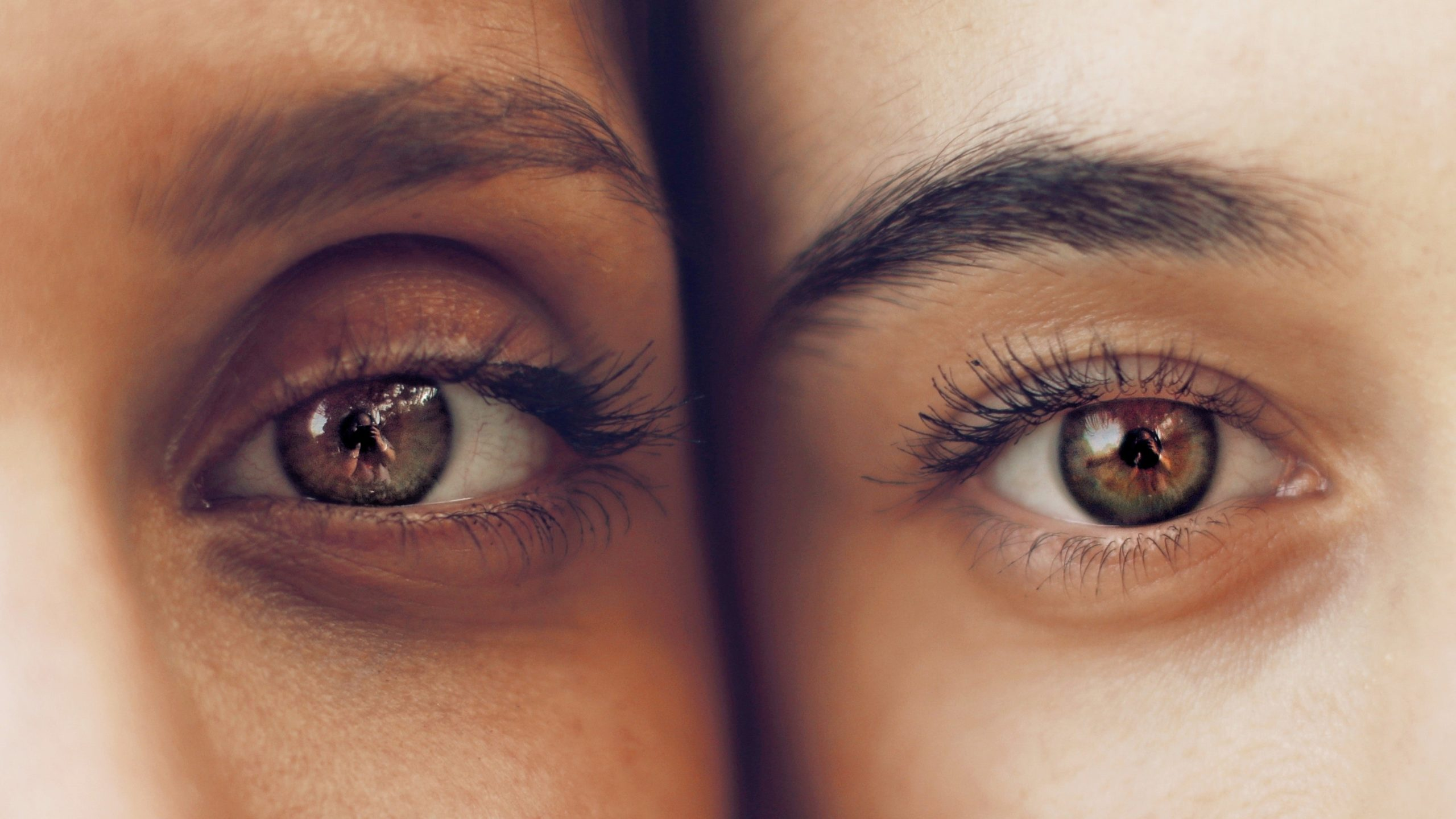 close up of two people, one eye each, with slight under eye darkness.