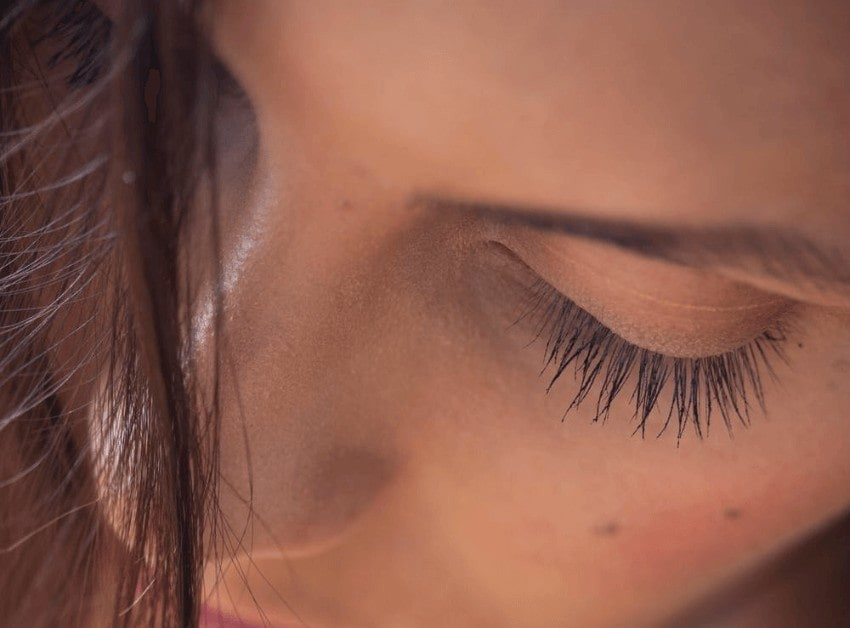 Woman wearing false eyelash extensions.