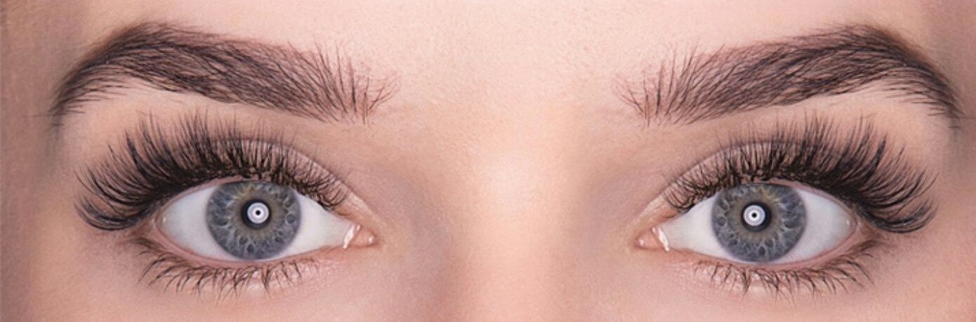 a close up of a models eyes, showing both upper and lower mink eyelash extensions.