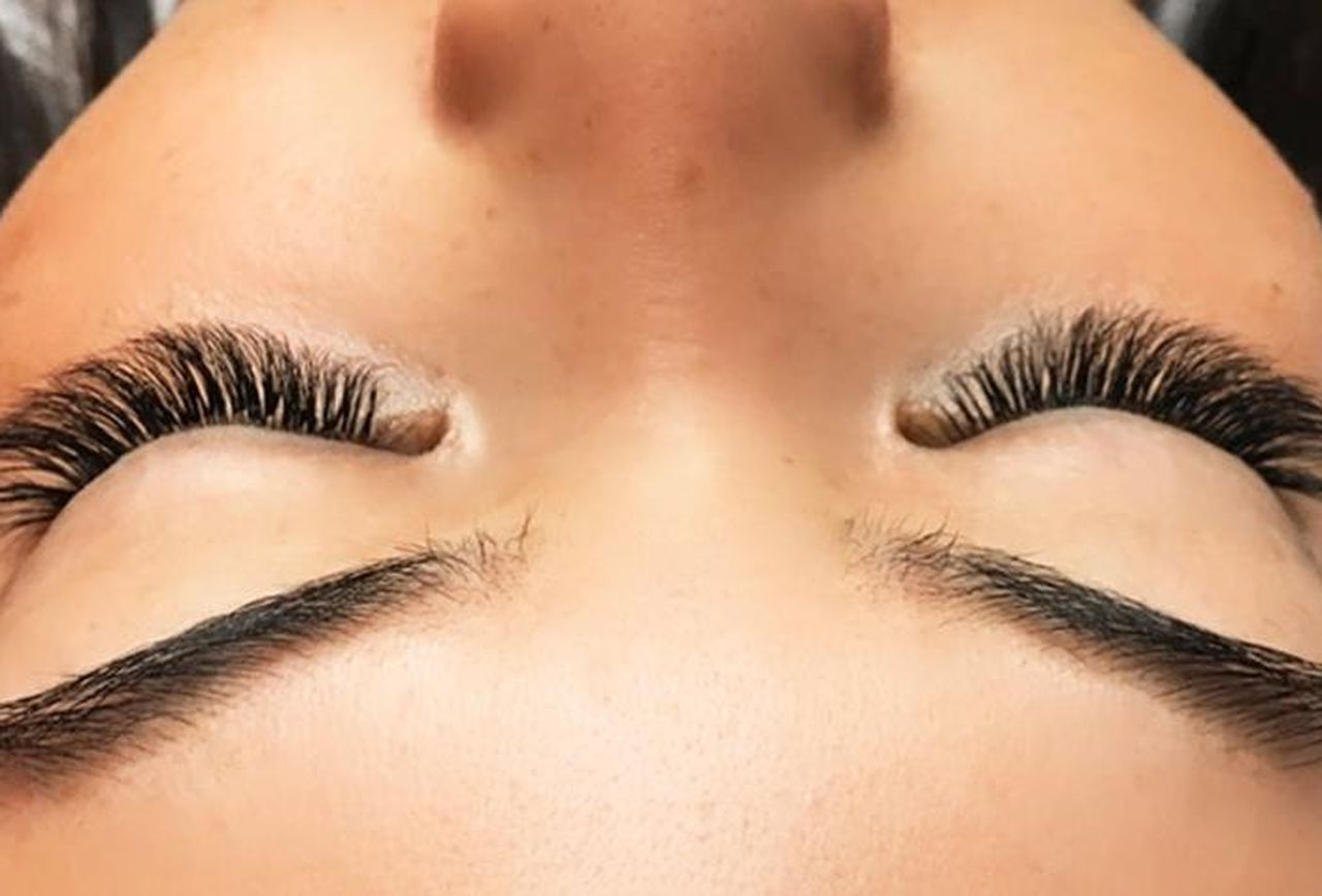 upside down view of woman's eyelash extensions.