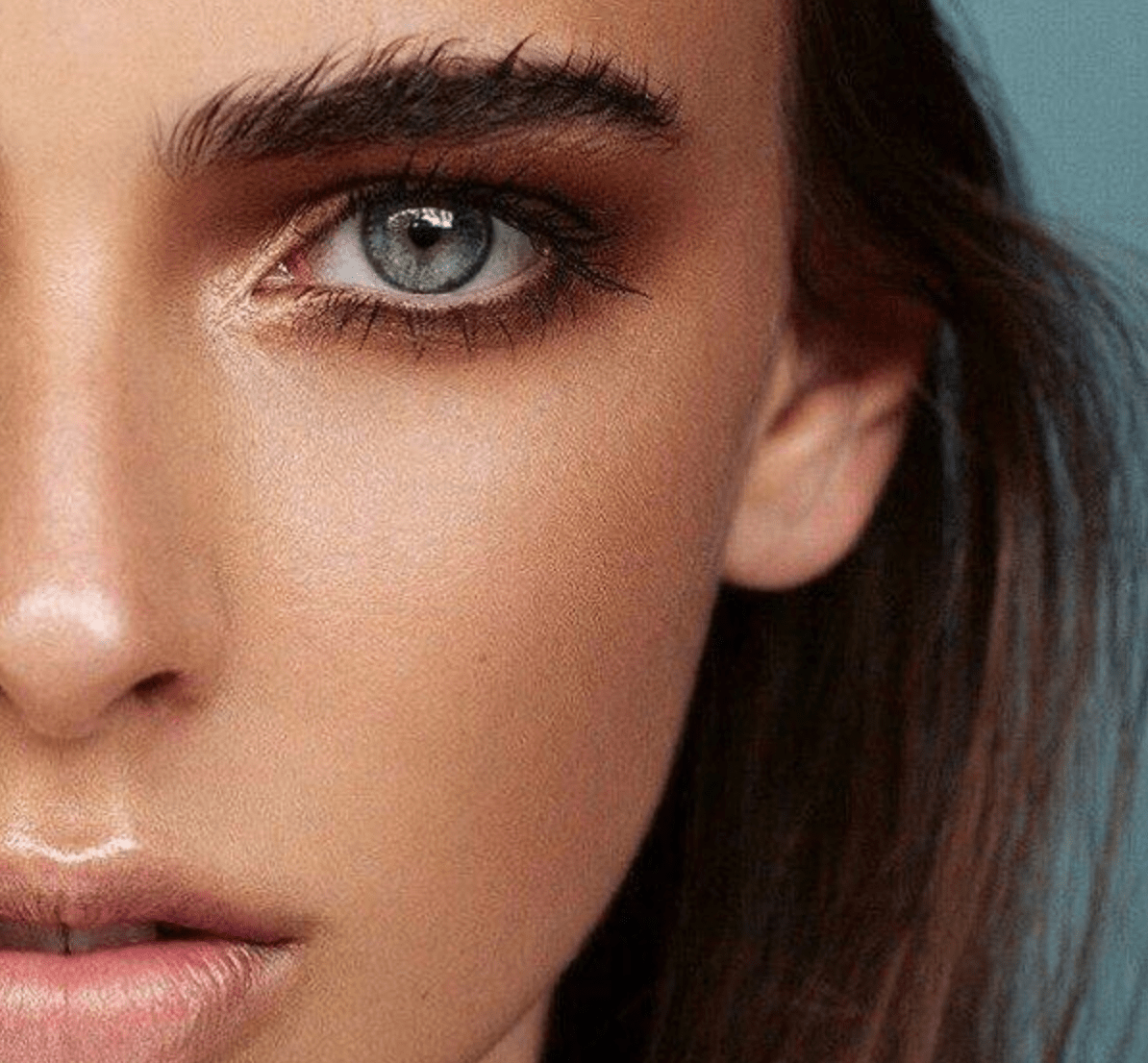 woman with bushy eyebrows, close up.