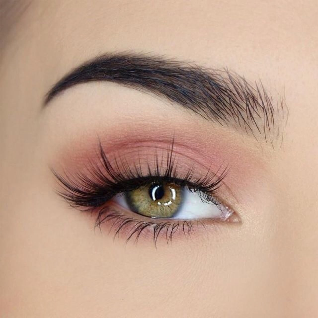 close up of womans eye, with nude eyeshadow and false eyelashes.