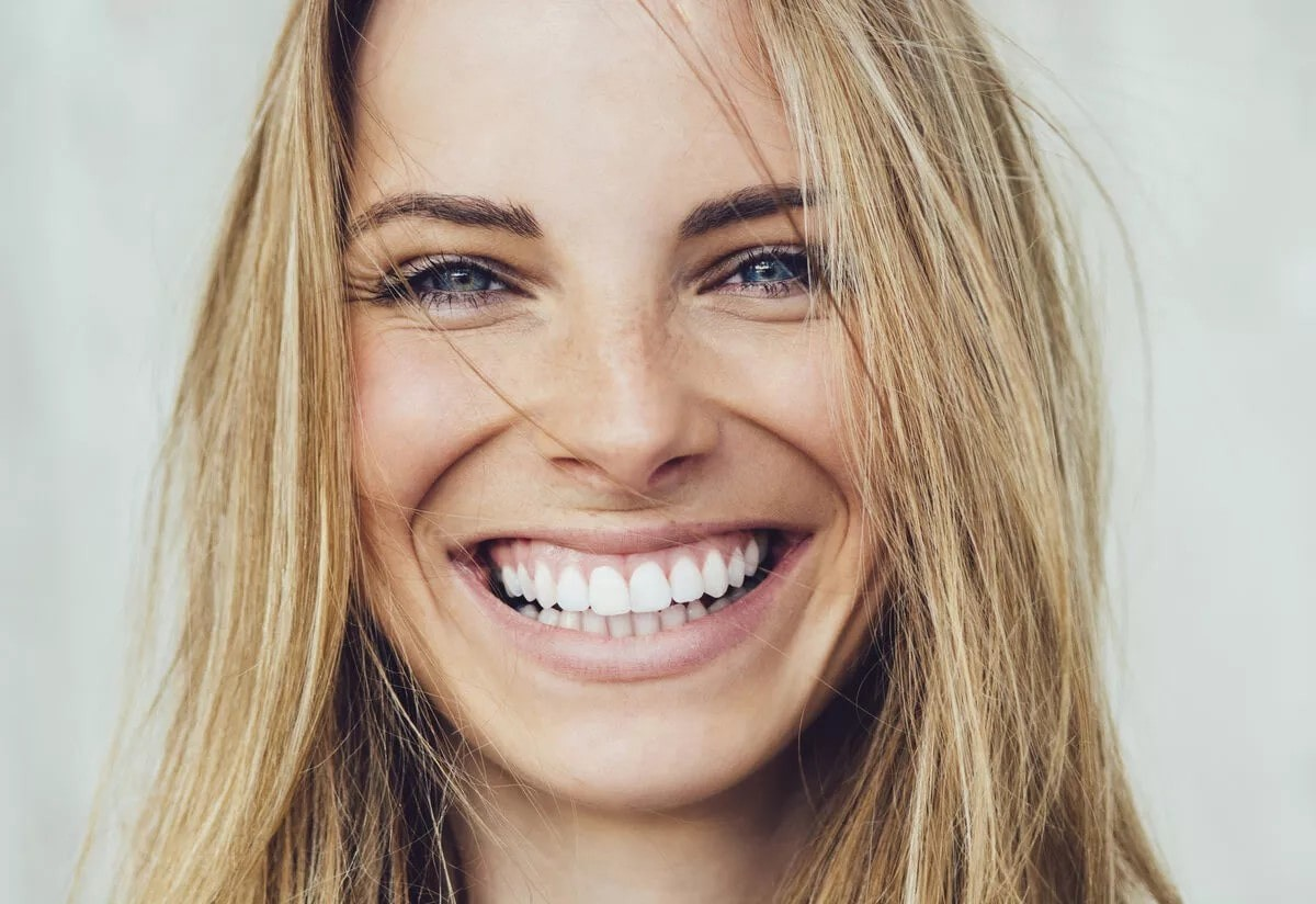 woman smiling a huge smile.