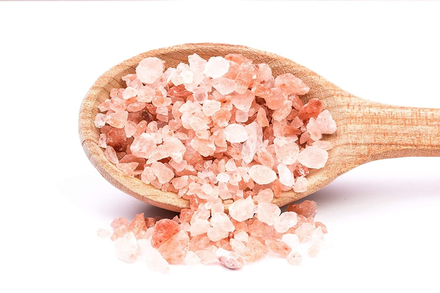 Pink Himalayan Salt on a wooden spoon.