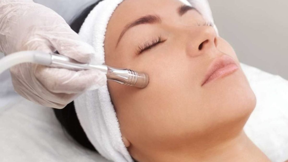 a woman having Microdermabrasion on her face.