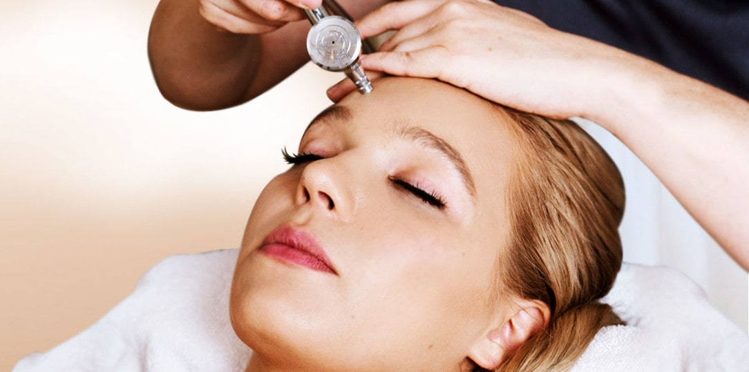 blonde haired woman having an oxygen facial.