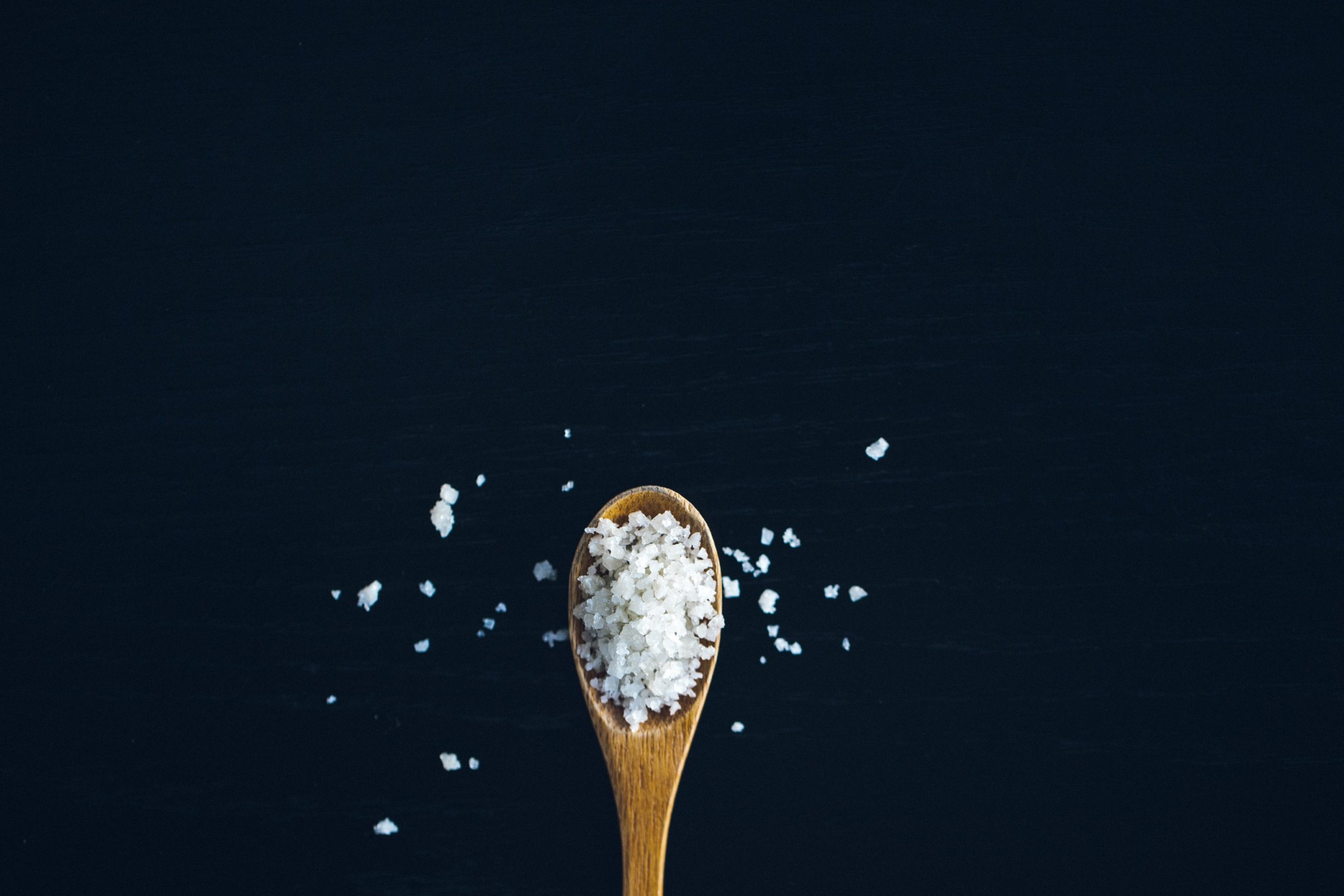 sea salt upon a wooden spatula.