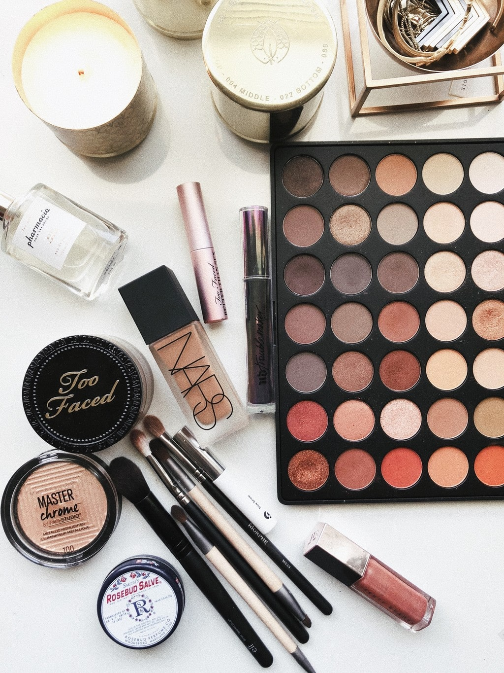 a range of expensive designer makeup products including an eyeshadow palette, lip gloss and foundation.