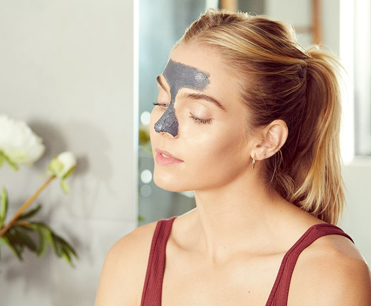 woman wearing a t-zone face mask.