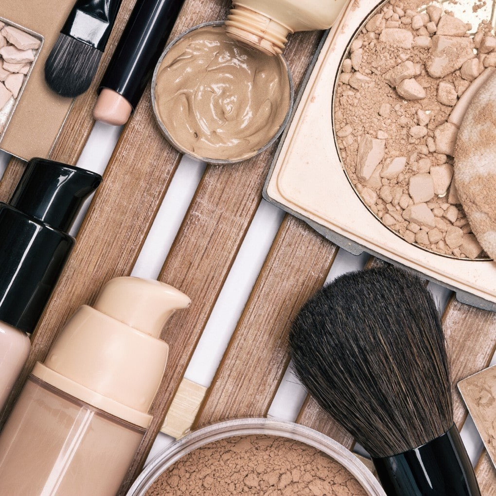 array of foundations and makeup applicator tools.