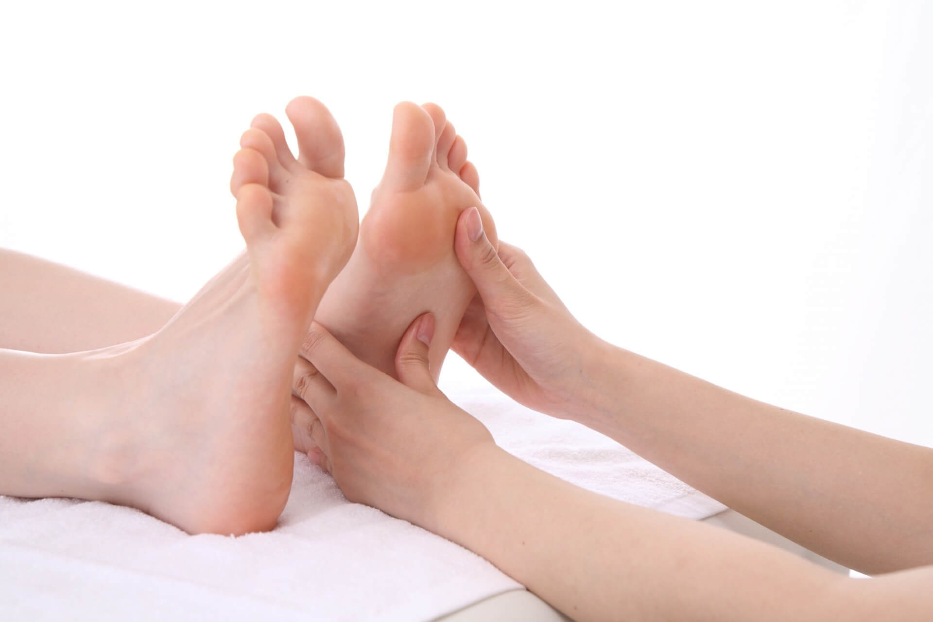 a pair of feet having reflexology.