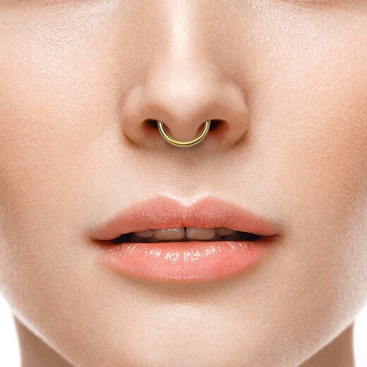 close up of a septum piercing.