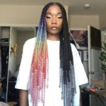 a woman with multi-coloured box braids.